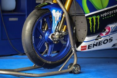 A Michelin tyre is seen mounted on the bike of Movistar Yamaha MotoGP rider Jorge Lorenzo of Spain during the second day of 2016 MotoGP pre-season test at the Sepang International circuit on February 2, 2016. AFP PHOTO / MOHD RASFAN / AFP PHOTO / MOHD RASFAN