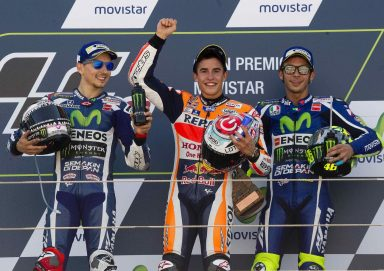 Spanish riders Marc Marquez (C) from Repsol Honda, Jorge Lorenzo (L) from Yamaha YZR M 1 and Italoian Valentino Rossi from Yamaha YZR M 1 celebrate their victory in the Aragon MotoGP Grand Prix at the MotorLand Aragon circuit near Alcaniz, Teruel, Spain 25 September 2016. EFE/Javier Cebollada